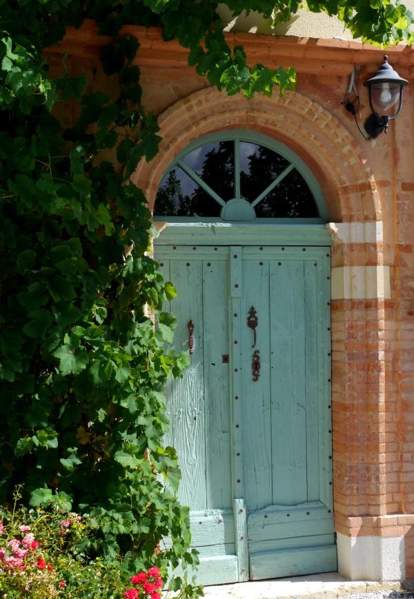 Door with vine, south facing, mud huts now hidden